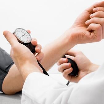 hands showing someone getting their blood presure taken