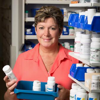 pharmacy technician with medicine bottles