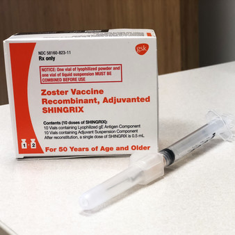 box of shingrix vaccine and needle